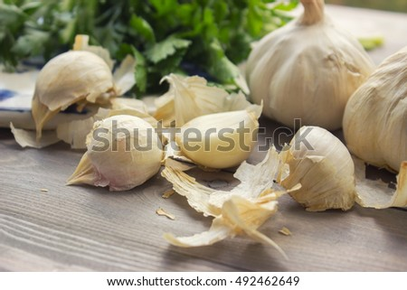Garlic cloves on wooden table