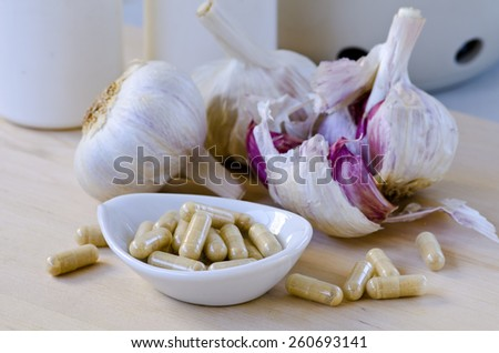 Garlic extract capsules. Dietary supplements. Selective focus. Taken in daylight. - stock photo