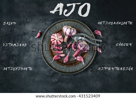 Garlic. Fresh garlic. Red garlic. Garlic press. Violet garlic.Garlic background. garlic bulbs. Medical health concept. Spanish text.  - stock photo