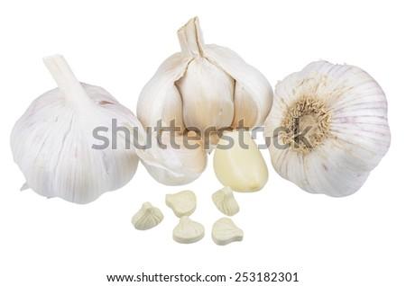 Garlic, garlic cloves and a dietary supplement based on garlic powder - stock photo