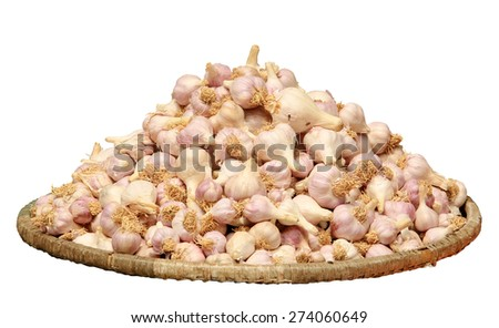 Garlic in a wicker basket on tne white background, isolate  - stock photo