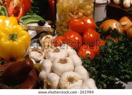 Garlic in Italian food setting - stock photo