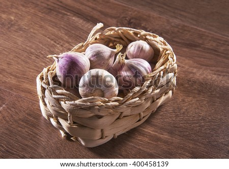 garlic in the basket - stock photo