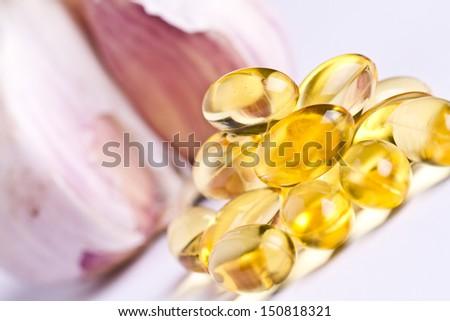 Garlic oil capsules. Vitamins d pills - stock photo