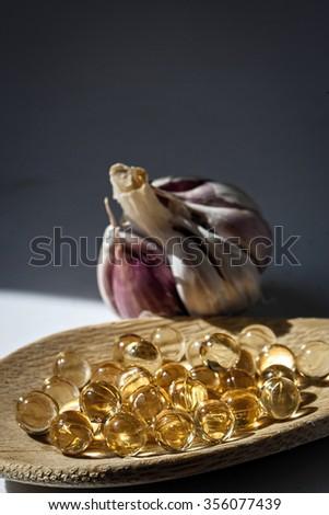 Garlic oil capsules, vitamins d pills  - stock photo