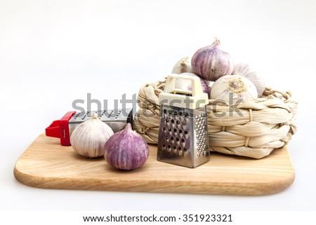 Garlic on a kitchen table - stock photo