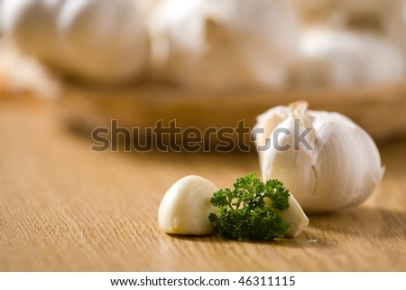 Garlic on a wooden table with decoration. Shallow dof. - stock photo