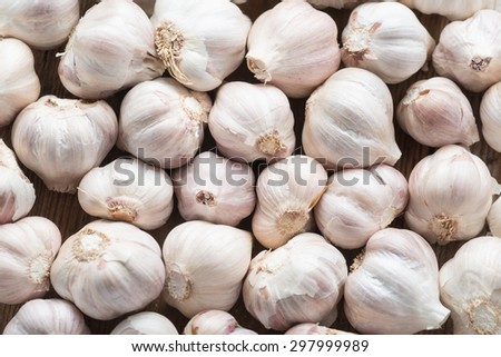 Garlic on the wooden background, top view. - stock photo