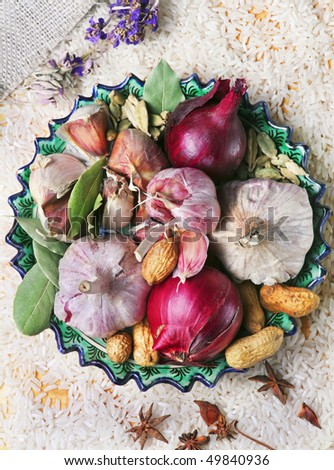garlic, onion and spices on the plate - stock photo