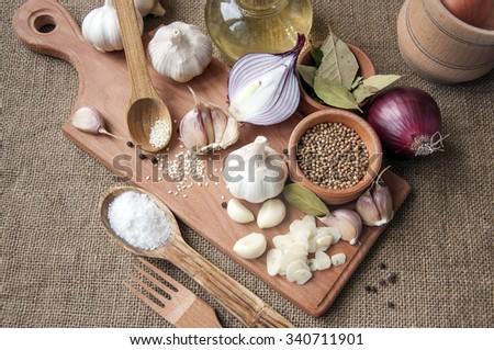 Garlic, onion, coriander, sesame seeds, black pepper, bay leaf,  - stock photo