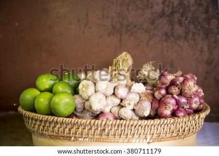 garlic, red onion, garlic in basket - stock photo