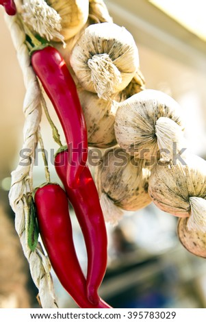 garlic ,red pepper ,peppers and garlic ,garlic outside ,dry garlic ,food,condiments,garlic floss ,natural garlic,fresh condiments ,spicy ,fresh vegetables ,round vegetables ,white vegetables,red fresh - stock photo