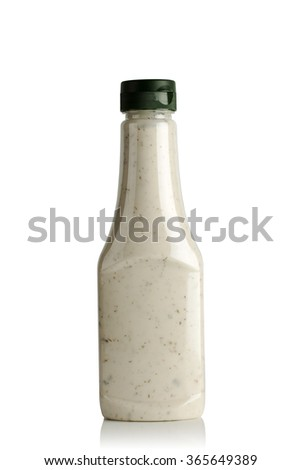 Garlic sauce in a plastic bottle on white background - stock photo