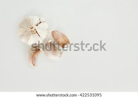 garlic vegetable ingredient top view on white background - stock photo