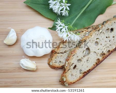 garlic with bread - stock photo