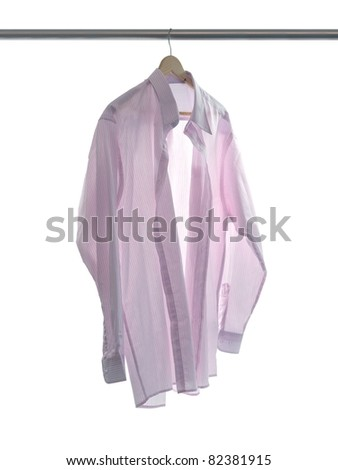 Garments hanging on coat hanger isolated against a white background - stock photo