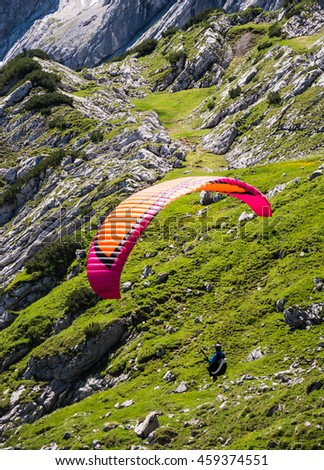 GARMISCH, GERMANY - JULY 10: Paraglider at the Osterfeldkopf mountain in Garmisch, Germany on July 10, 2016. - stock photo