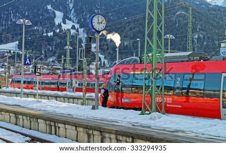 GARMISCH-PARTENKIRCHEN, GERMANY - JANUARY 6, 2015: View of the train driver awaiting departure at Garmisch-Partenkirchen train station on a sunny winter afternoon. Bavaria. Germany - stock photo