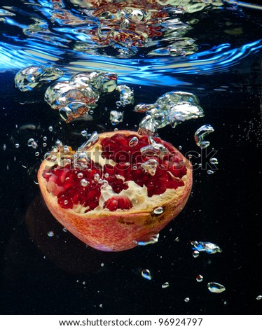 Garnet in the water on a black background - stock photo