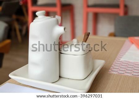 Garnish in White bottle - stock photo