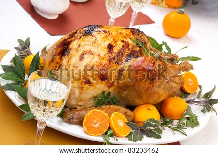 Garnished citrus glazed roasted turkey on holiday table, pumpkins ...