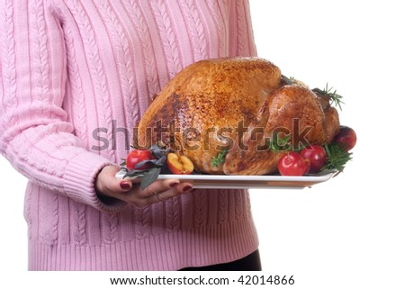 Garnished roasted turkey on platter is ready to be served