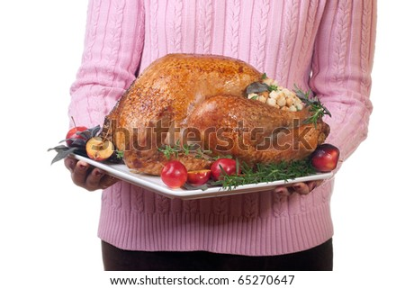 Garnished roasted turkey on platter is ready to be served - stock photo