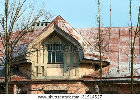 garret window of old mansion - stock photo