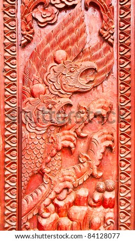 Garuda carved on temple door,state symbol of thailand