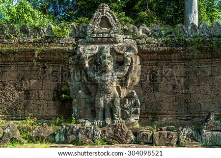 Garuda or demon placed in the wall of the entry of the archaeological enclosure of preah khan in siam reap, cambodia
