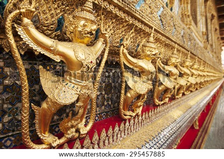 Garuda,The statues of Krut battling naga serpent, a Thai Buddhist adaptation of Garuda in Wat Phra Kaeo temple, Bangkok