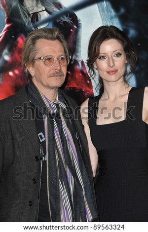 "Gary Oldman & Donya Fiorentino at the Los Angeles premiere of his new movie ""Red Riding Hood"" at Grauman's Chinese Theatre, Hollywood. March 7, 2011  Los Angeles, CA Picture: Paul Smith / Featureflash"