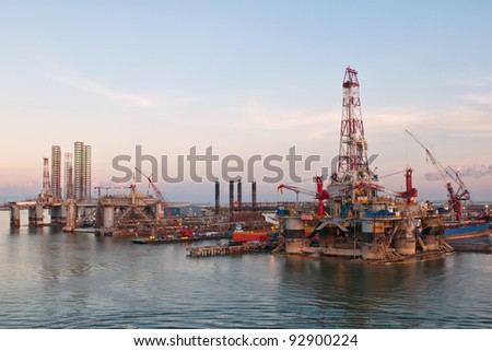 Gas and oil rig platform at sunrise at port. - stock photo