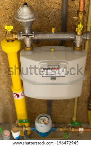 Gas and water meter in a modern home. - stock photo