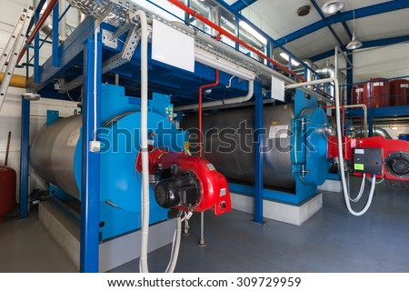 Gas boilers in gas boiler room  - stock photo