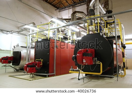 Gas boilers in gas boiler room for steam production - stock photo