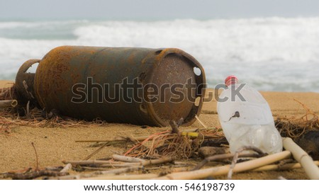 Gas bottle on the beach in Sicily