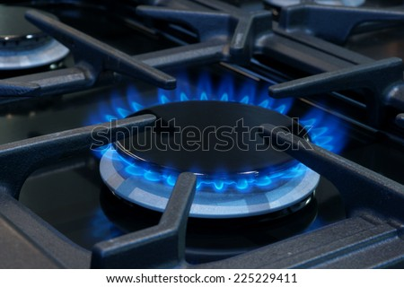 Gas burner on a domestic cooker or stove - stock photo