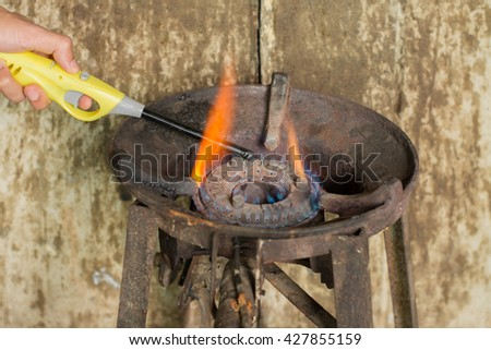 Gas burning from a kitchen gas stove,Old steel Gas hob cooker. - stock photo