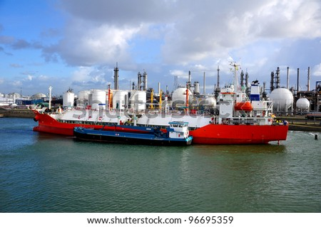 gas-carrier in port for loading and  bunkering operations - stock photo