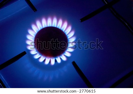 Gas cooker with burning fire - stock photo