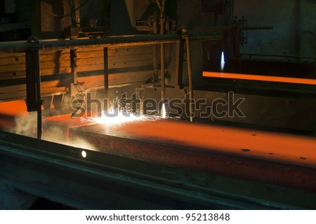 Gas cutting of the hot metal inside of plant