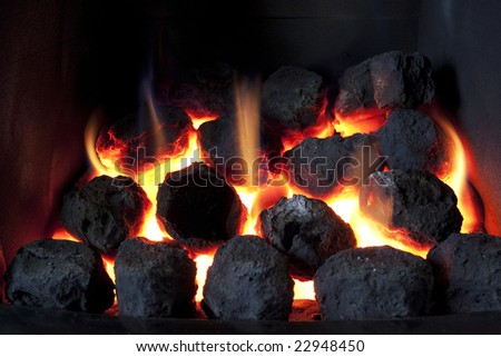 gas fire burning with artificial coals