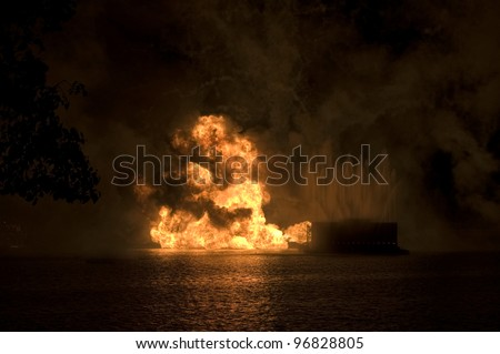 Gas fire explosion on water at night - stock photo