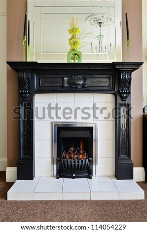 Gas fireplace and surround - stock photo