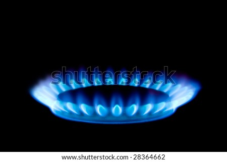 Gas flame isolated on black background - stock photo