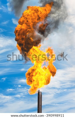 Gas flaring. Combustion of associated gas at oil production. - stock photo