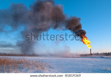 Gas flaring. Evaporation of snow. - stock photo
