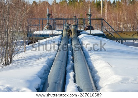 Gas lines in the snow - stock photo