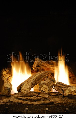 Gas logs fireplace - stock photo